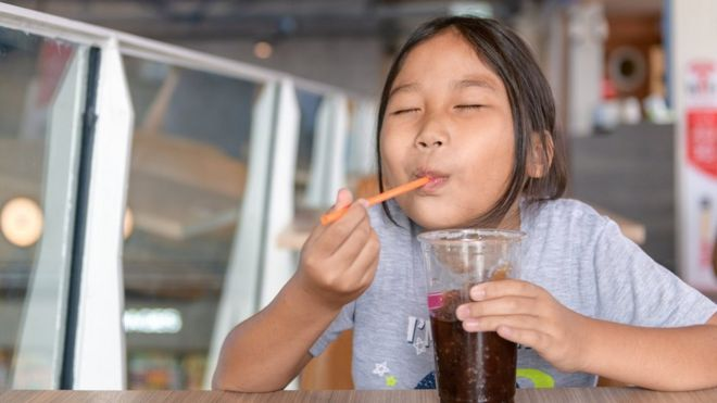 Child with a sugary drink