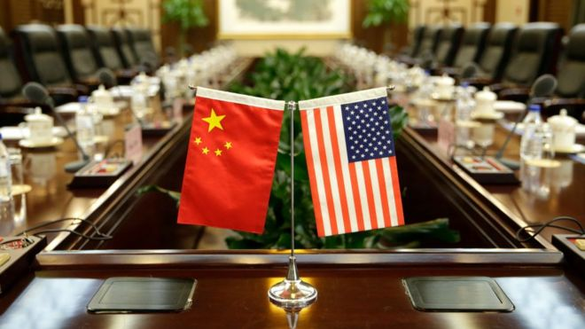 Flags of the US and China are placed ahead of a meeting