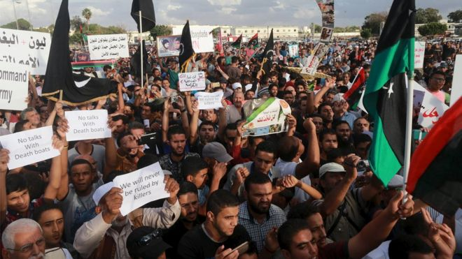 Benghazi attack six die as mortars hit libya protest bbc news people take part in a protest against candidates for a national unity government proposed by un sciox Choice Image