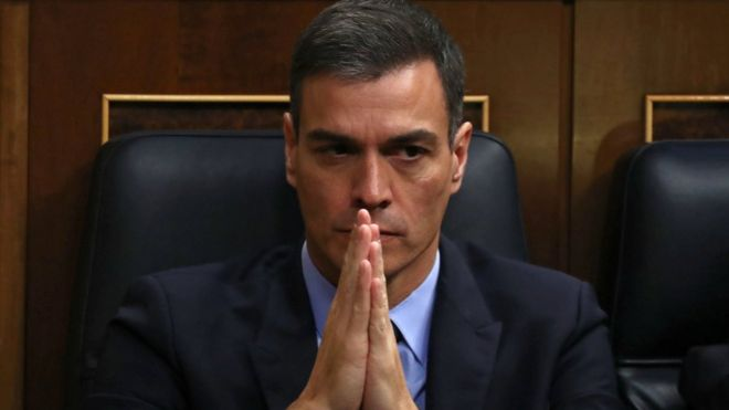 Spain's Prime Minister Pedro Sanchez clasps his hands together almost as if in prayer in this close-up from the Spanish parliament on Wednesday
