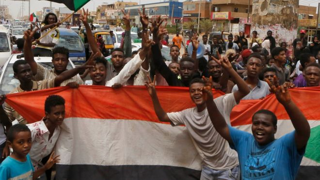 Sudanese people celebrate in the streets of Khartoum after ruling generals and protest leaders announced they had reached an agreement on the disputed issue of a new governing body on 5 July