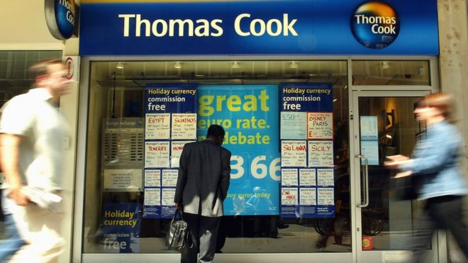A man looks at the window display of travel agency Thomas Cook July 28, 2003 in London, England.