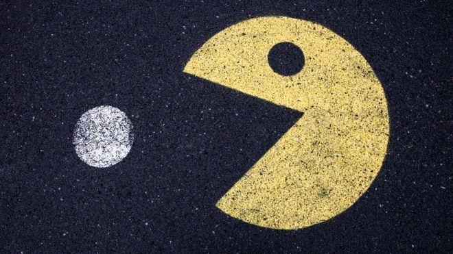 Pacman-like character drawn in chalk