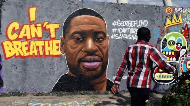 Un mural con la imagen de George Floyd