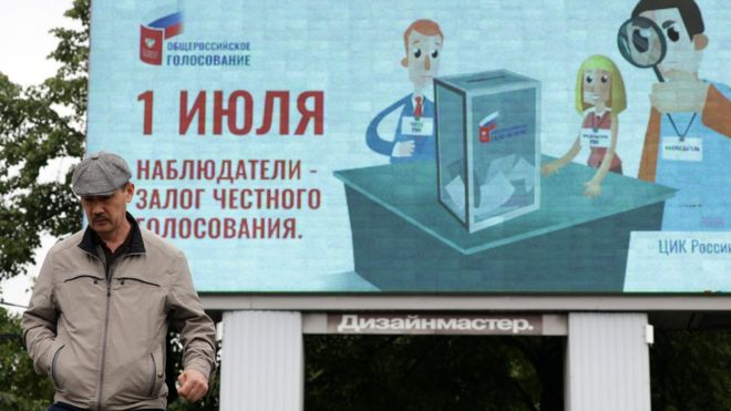 """A billboard poster promoting the 2020 Russian constitutional referendum and reading """"1 July; Observers are guarantee for fair voting"""" in a street. The 2020 Russian constitutional referendum is to be held on July 1, 2020."""