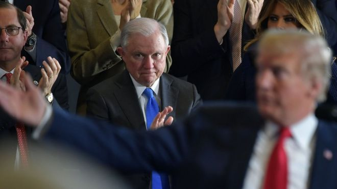 Attorney General Jeff Sessions (C) and First Lady Melania Trump (R) applaud during a speech by US President Donald Trump, 19 March 2018