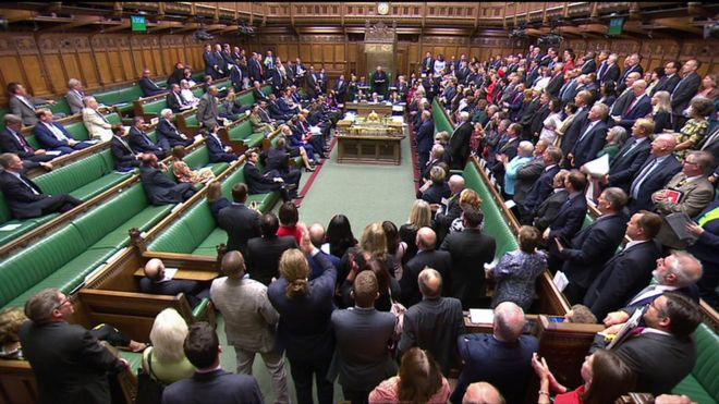 MPs standing in the House of Commons in support of an emergency debate