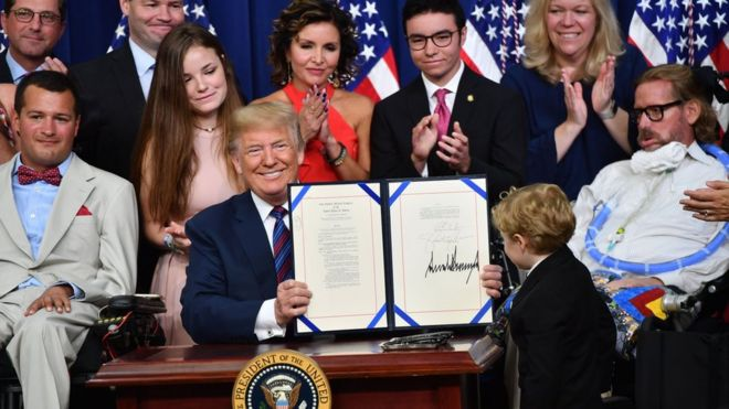 """US President Donald Trump smiles after the signing of the """"Right To Try Act"""", which allows terminally ill patients to seek treatment using drugs that have not yet been approved, at the White House in Washington, DC, on May 30, 2018. /"""