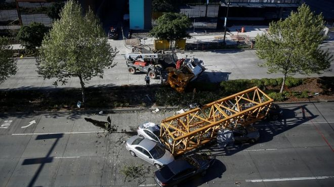 Four die as crane collapses across Seattle street - BBC News
