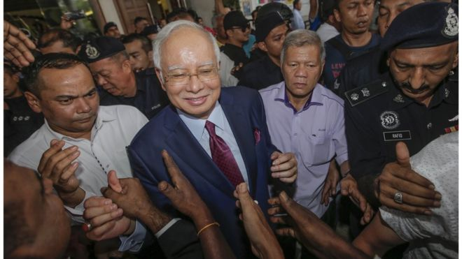 Former Malaysian prime minister Najib Razak (C) is greeted by his supporters as he leaves the Kuala Lumpur High Court, in Kuala Lumpur, Malaysia, 04 July 2018.