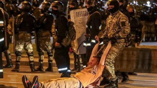A police officer drags a man during clashes with opposition supporters in Minsk, Belarus. Photo: 9 August 2020