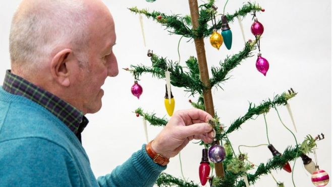 Steve Rose with his Christmas tree - Vintage 1930s Woolworths Christmas Tree Auctioned - BBC News