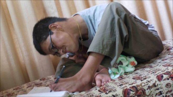 Nepal's prize-winning poet with cerebral palsy - BBC News
