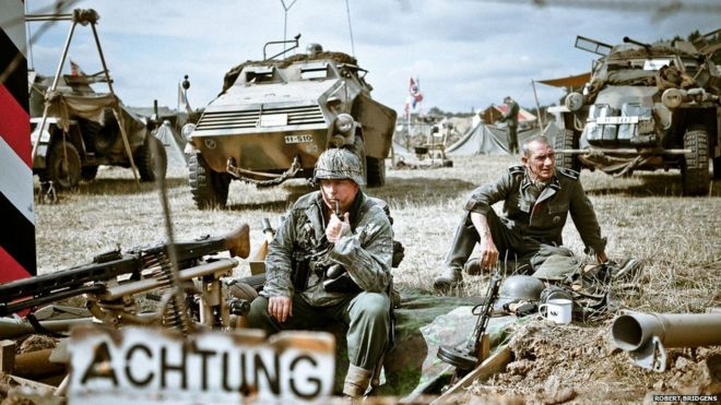In pictures: Vivid WWII re-enactments caught on camera - BBC