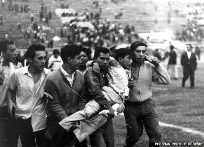 Youths carrying boy
