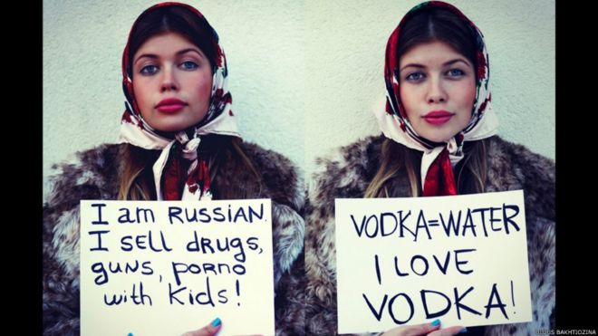 One Woman Holding A Sign Saying I Am Russian I Sell Drugs And Another