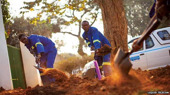 Liquid Telecom workers laying cable