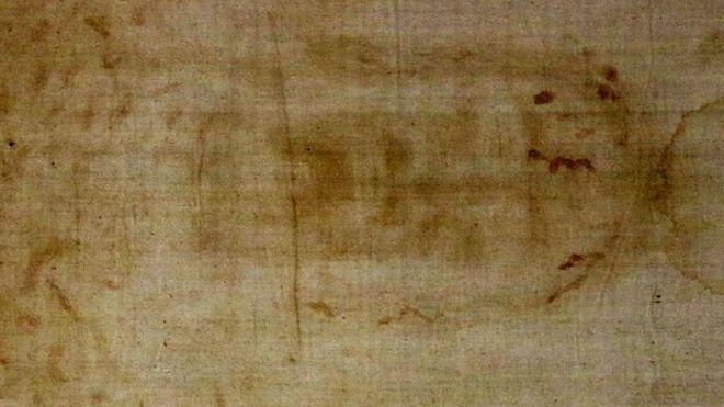 Turin Shroud goes back on display at city's cathedral - BBC News