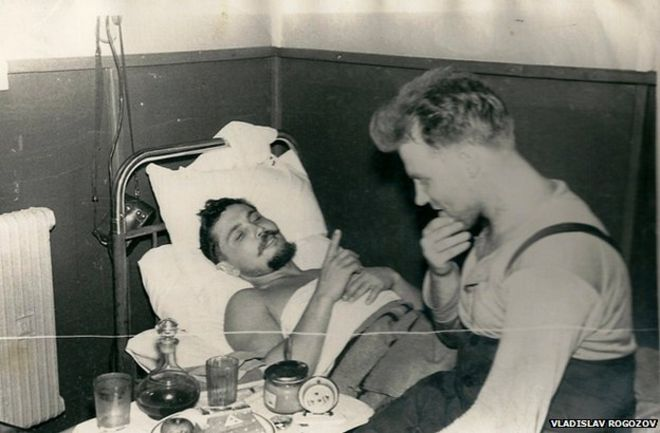 leonid with his friend during surgery