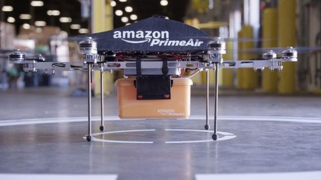 Amazon details drone delivery plans bbc news amazon octocopter on display malvernweather Image collections