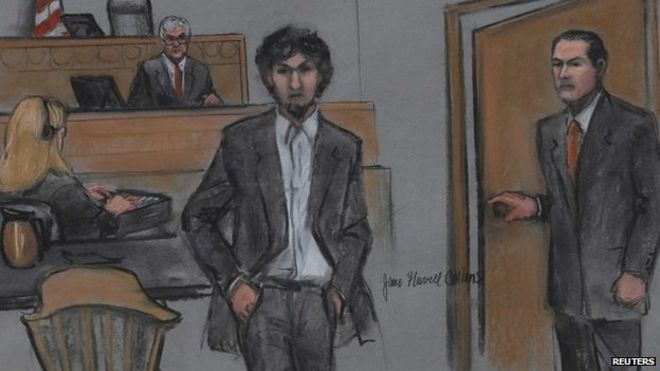 In this courtroom sketch, Dzhokhar Tsarnaev, second from left, is depicted  standing with