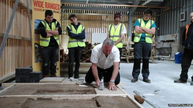 Yeovil College new construction skills centre (picturing Tommy Walsh showing off paving skills to students there during the opening day)