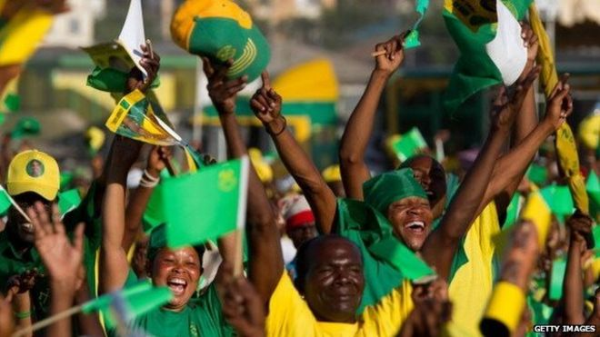 Supporters cheer Tanzanian President Jakaya Kikwete as their leader delivers a speech on October 30, 2010 during the final campaign rally in Dar Es Sallam on the eve of elections he is expected to win.