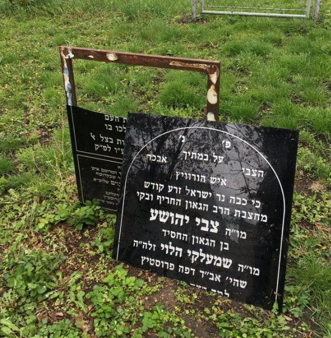 A replica tombstone is broken in half
