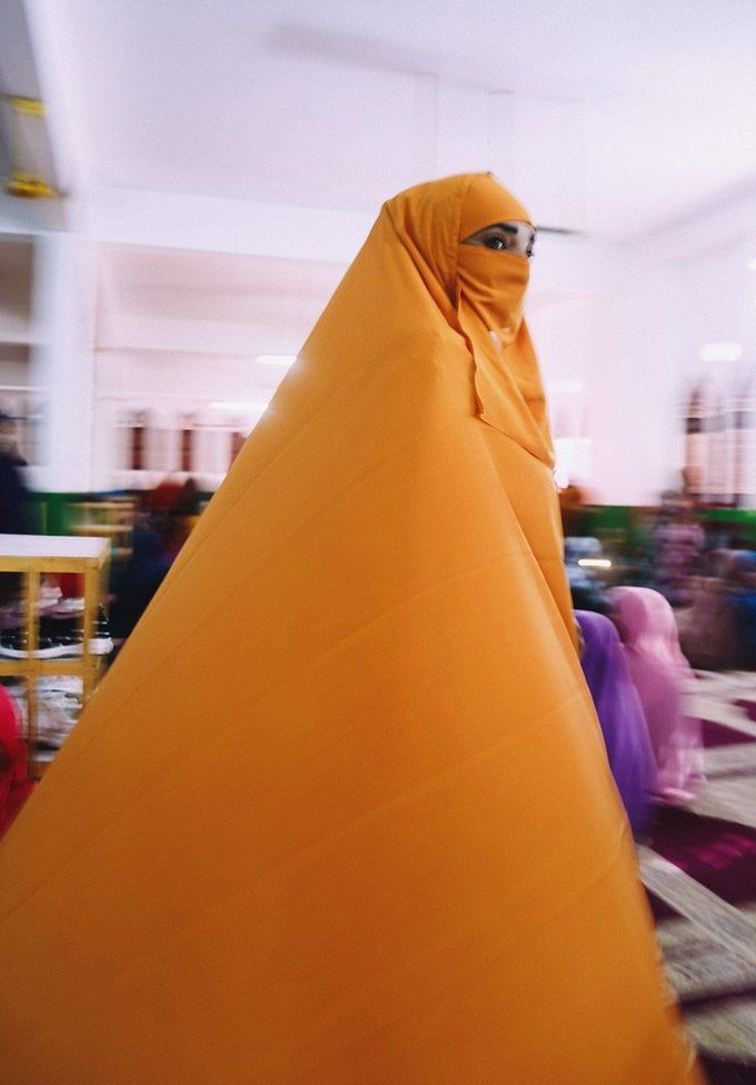 Woman wearing orange jilbab