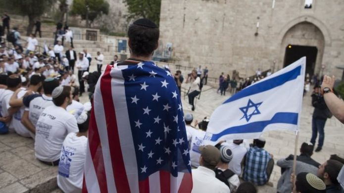 An Israeli man wearing US flag at a march in Jerusalem. Photo: 13 May 2018