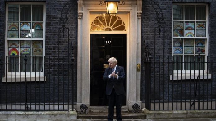 """British Prime Minister Boris Johnson takes part during the """"Clap for our Carers"""" campaign in support of Britain""""s National Health Service (NHS) in front of 10 Downing Street in central London"""