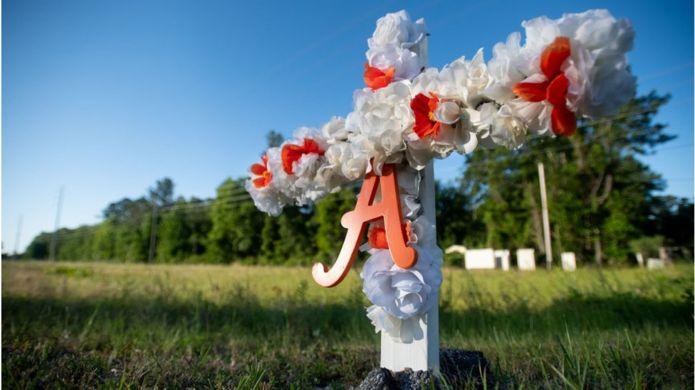 A cross for Ahmaud Arbery outside the neighbourhood he was shot in