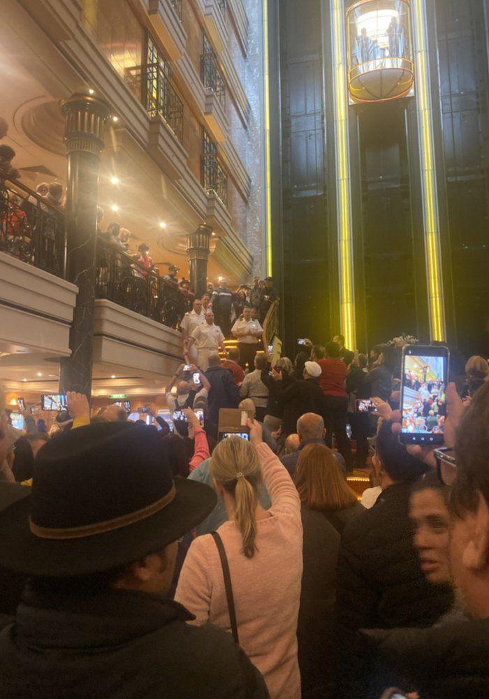 Passengers crowd around a stairway on the Norwegian Spirit
