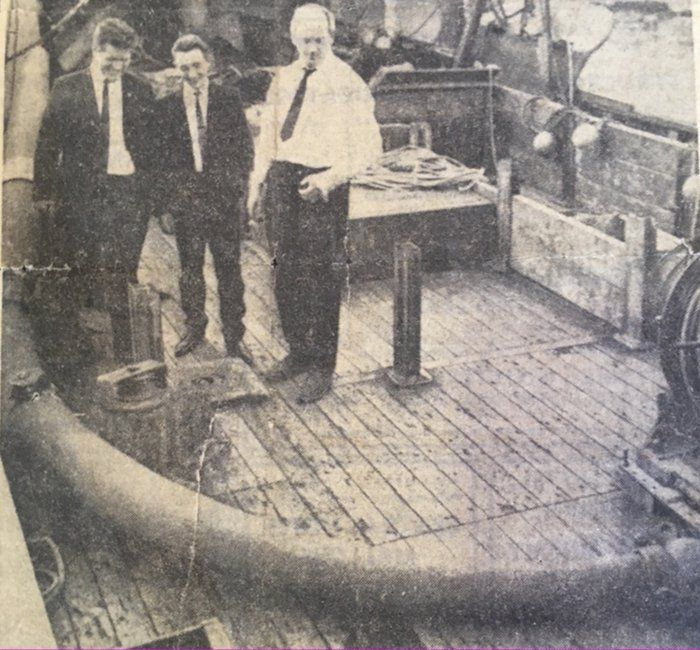 three men pictured with the davit