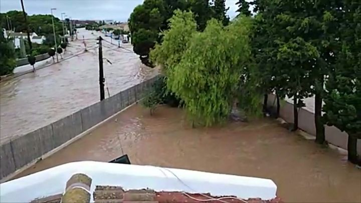 Spanish floods: Family trapped in attic