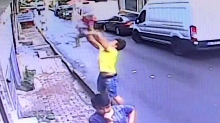 'Hero' 17-year-old catches falling toddler