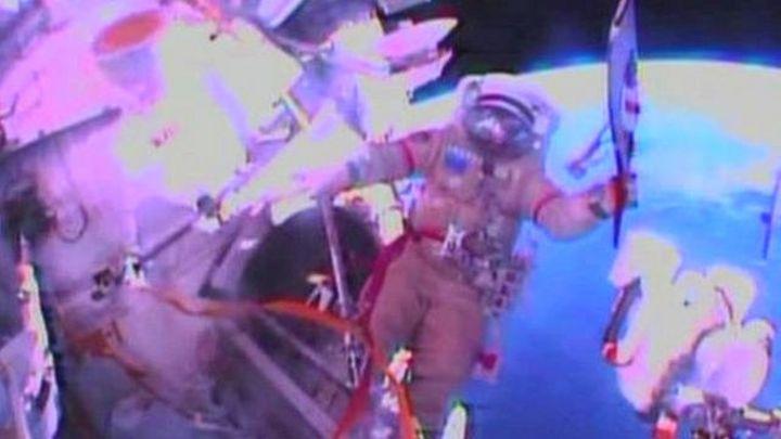 Sochi Olympic torch taken on historic spacewalk