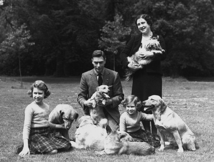 King George VI (1895 - 1952) and Queen Elizabeth with Princesses Margaret Rose (1930 - 2002) and Elizabeth (left) in the grounds of Windsor Castle, Berkshire, 1936