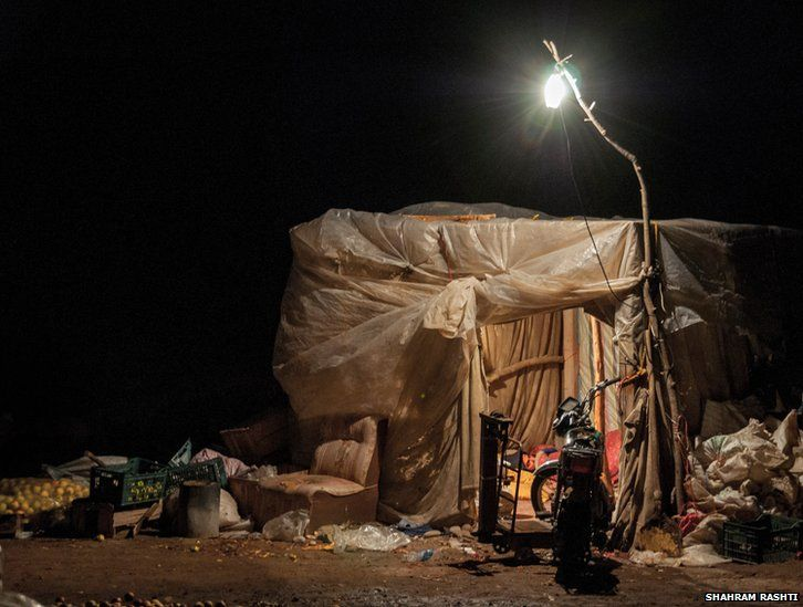 A street vendor sleeps in his make shift tent after a hard days work in Maraghe, Iran