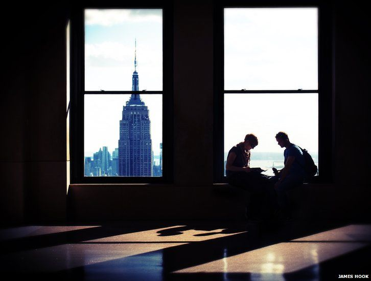 Couple in a window in New York