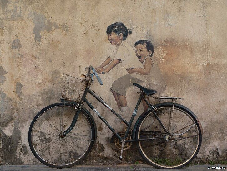 Bicycle and painted children