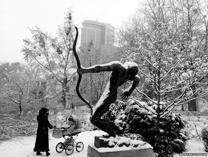 A Ukrainian woman walking in the park in Kiev, Ukraine
