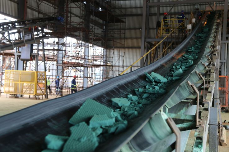 A conveyor belt carries chunks of Raw cobalt after a first transformation at a plant in Lubumbashi on February 16, 2018, before being exported, mainly to China, to be refined.