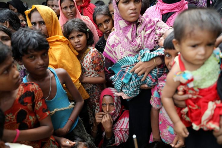 Rohingya refugees wait for humanitarian aid to be distributed at the Balu Khali refugee camp in Cox's Bazar, Bangladesh 5 October 2017.