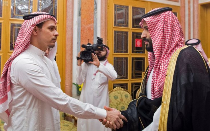 Salah Khashoggi shakes the hand of Saudi Crown Prince Mohammed bin Salman