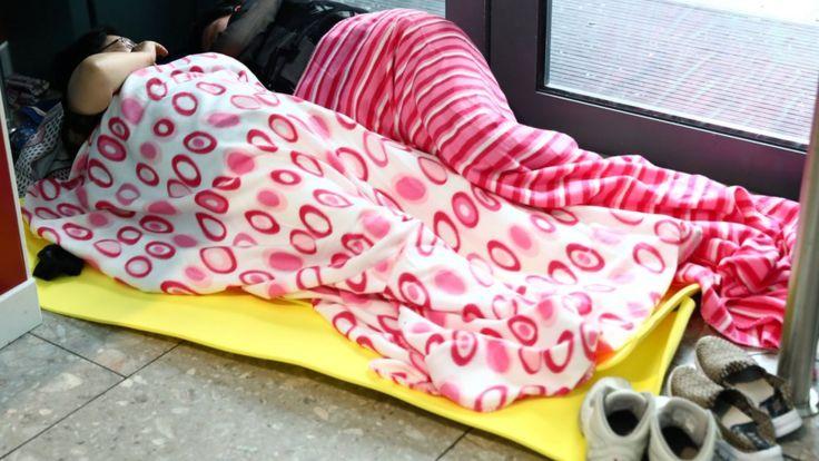 People sleep at Heathrow Terminal 5 in London