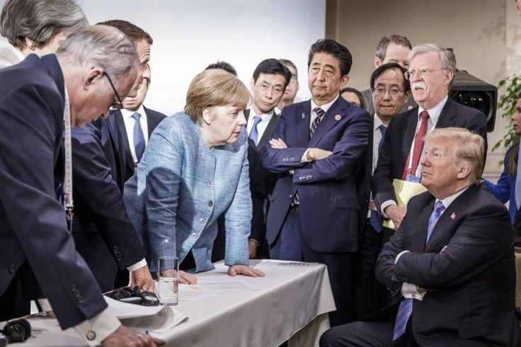 World leaders talk around a table at the G7 summit