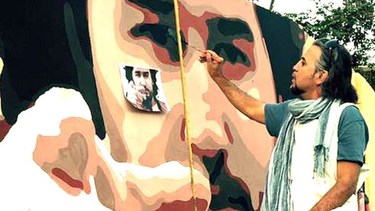 Omaid Sharifi working on a painting