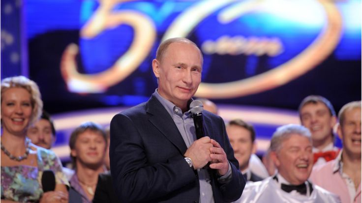 Russia's then Prime Minister, Vladimir Putin, attends a show to mark the 50th anniversary of the TV comedy show KVN in Moscow on 13 November 2011.