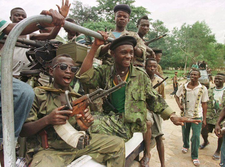 RUF ( Revolutionary United Front ) soldiers ride in a pick up truck at their base in the outskirts of Freetown Tuesday, June 10, 1997